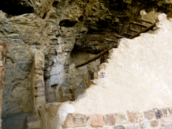 Partial wall and beams from the dwellings.
