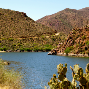 The Salt River with the Apache trail winding above it.