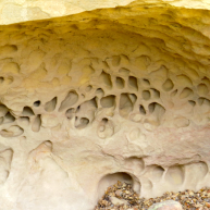 The wind does delicate sculptures in the sandstone.
