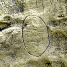 One of the first inscriptions you see is this little face.