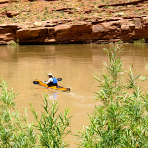Greg departing in his Kayak. Notice the color of the water here.