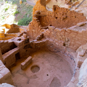 Looking down on an open Kiva one can see the fire pit, ventilation hole and shield. The small hole towards the left is called a sipapu and it is believed to be a ritual entrance from another world.